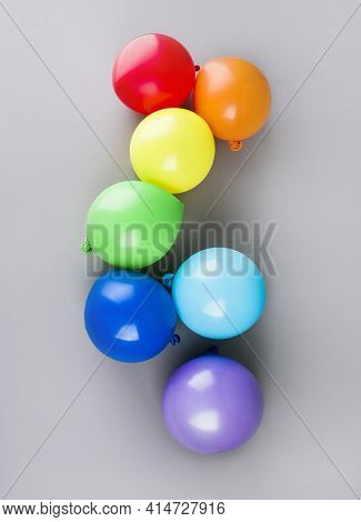 Small Multicolored Inflatable Balls In The Rainbow Palette, Art Concept. Colorful Balloons. Graduati