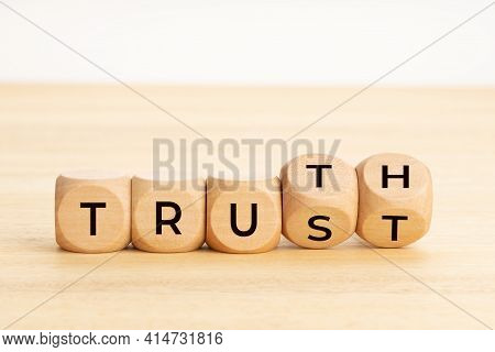Truth Or Trust Concept. Text On Wooden Blocks. White Background. Copy Space