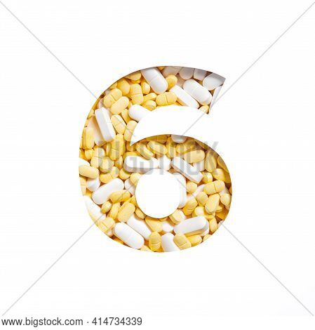 Number Six Made Of Pills And Paper Cut In Shape Of Sixth Numeral Isolated On White. Typeface Of Tabl