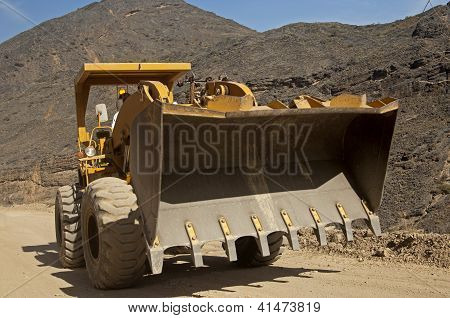 Front loader with an over-sized square bucket