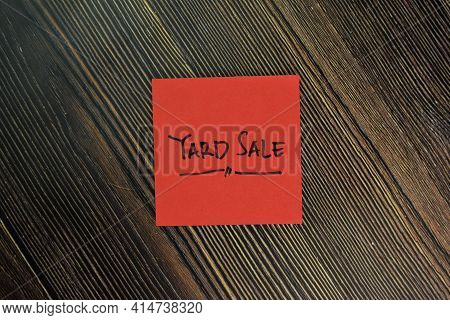 Yard Sale Write On Sticky Notes Isolated On Wooden Table.