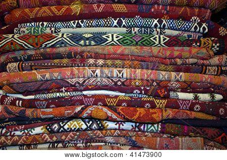 Piles of carpets at a a carpet merchant