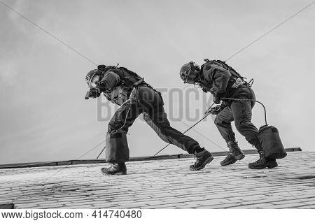 Two Commandos Train At The Base. Climbers. Swat, Police, Counterterrorism Concept. Mixed Media