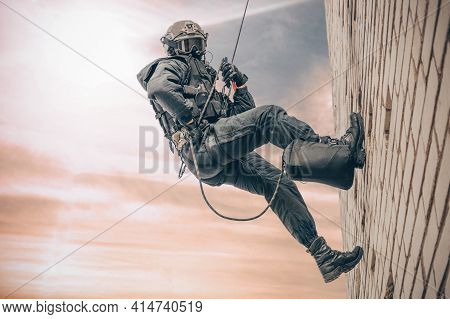 Special Forces Fighter Descends From A Skyscraper To Storm The Apartment. Swat, Police, Counter Terr
