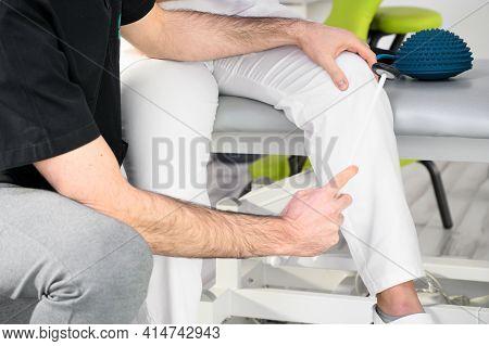 Neurological Examination. The Neurologist Testing Reflexes On A Female Patient Using A Hammer. High