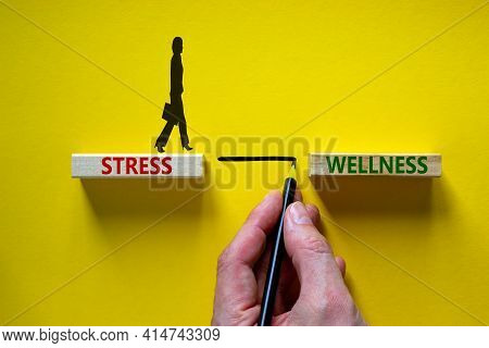 Stress Or Wellness Symbol. Wooden Blocks With Words 'stress, Wellness'. Yellow Background. Businessm