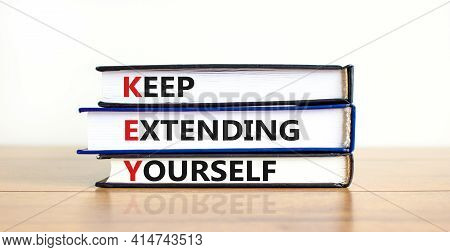 Key, Keep Extending Yourself Symbol. Books With Words 'key, Keep Extending Yourself'. Beautiful Whit