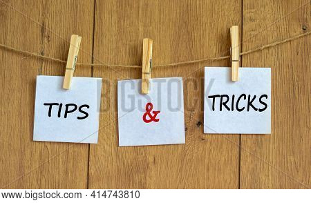 Tips And Tricks Symbol. White Papers On Wooden Clothespins. Words 'tips And Tricks'. Beautiful Woode