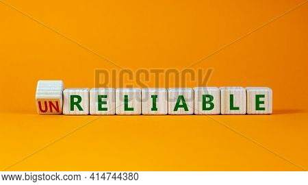 Unreliable Or Reliable Symbol. Turned Wooden Cubes And Changed The Word Unreliable To Reliable. Beau