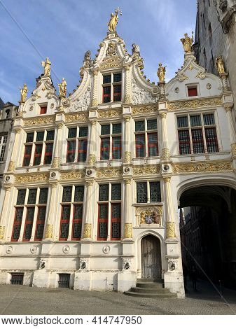 Brugges, Belgium - May 27, 2019: Market Square, Brugges Main Square With Traditional Architecture