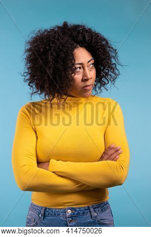 Offended African Woman Keeping Arms Crossed, Feeling Mad At Someone. Human Facial Expressions, Emoti