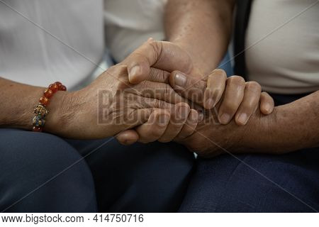 Close Up Of The Hand Of An Elderly Lover. The Mature Wife Holds The Hands Of Her Husband For Encoura