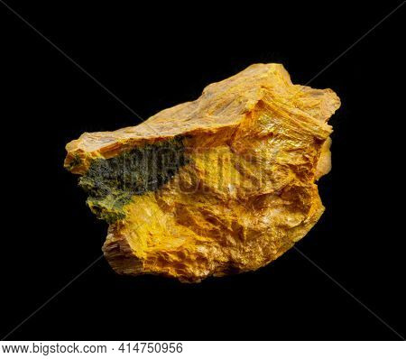 Bright Yellow Gold Orpiment Aka Auripigmentum Mineral From Middle Asia Isolated On Black Background.