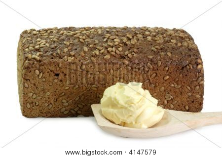 Multi-grain-bread and oleo on a cooking spoon on white background poster