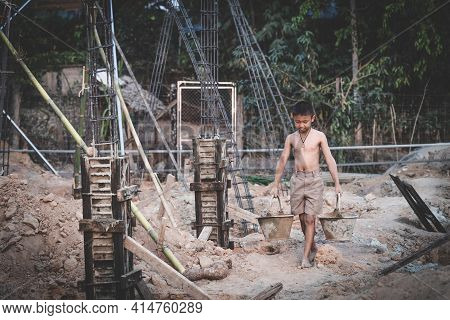 Children Are Forced To Work In Construction Areas. Fear Of Child Labor And Human Trafficking. Human