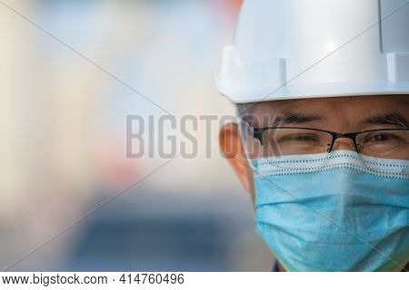 Close Up Asian Man Engineer Wear Medical Mask Working In Site Construction, Old Man Concept Retireme