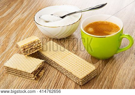 Spoon In White Bowl With Sugar, Halves Of Wafer, Whole Wafer With Chocolate Filling, Coffee Espresso