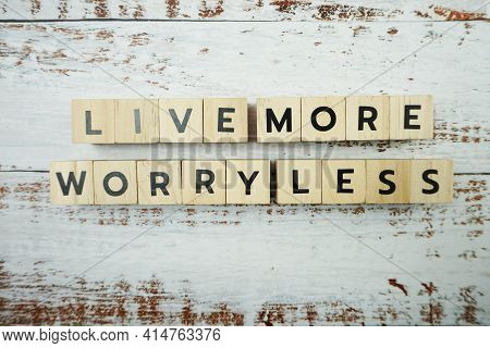 Live More Worry Less Word Alphabet Letters On Wooden Background
