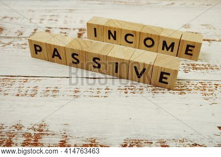 Passive Income Word Alphabet Letters On Wooden Background