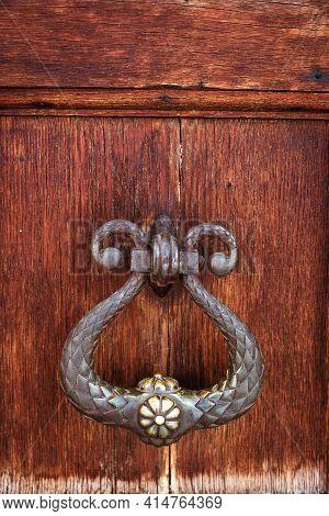 Vintage, Metal Door Knocker Close-up On Dark Wood Background