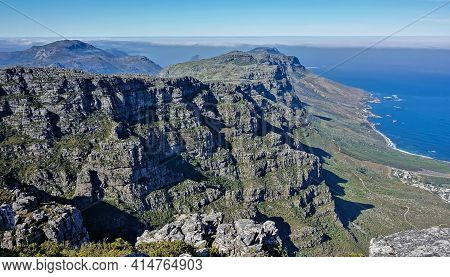 Mountain Landscape At The Top Of Table Mountain In Cape Town. Sheer Rocky Slopes With Green Vegetati