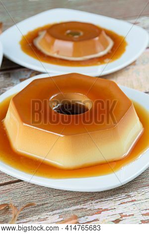 Condensed Milk Pudding With Caramel Syrup. Dulce De Leche Pudding In The Background. Brazilian Tradi