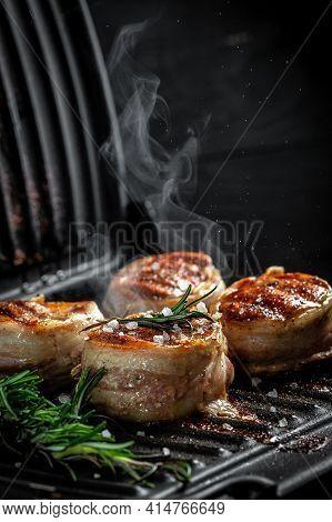 Filet Mignon Beef Tenderloin Steak Is Grilled In A Grill. Tenderloin Steaks Wrapped In Bacon. Ground
