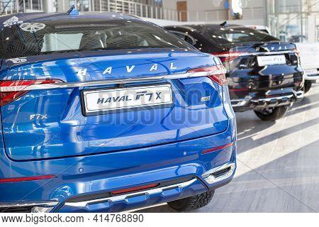 Russia, Izhevsk - February 17, 2021: Haval Showroom. New Modern Haval F7x Cars In Dealer Showroom. B
