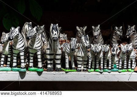 Rows Of Zebra Figurine Made Of Paper Mache, Commonly Seen In Spirit Houses As An Offering To The Gua