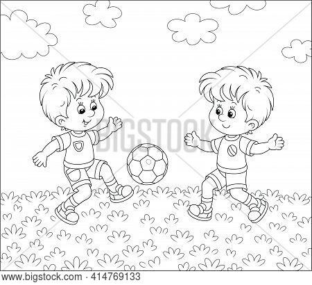 Little Football Players Kicking A Colorful Ball At A Match Or Training On A Sports Field, Black And
