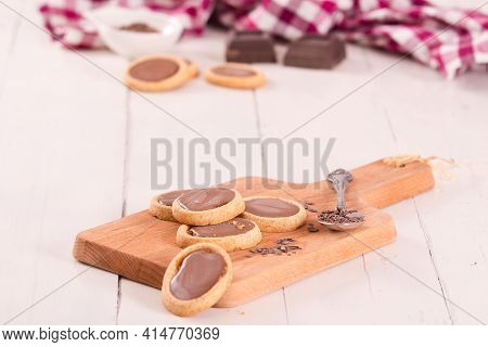 Shortcrust Pastry Biscuits With Chocolate On Cutting Board.