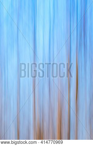 Abstract Blue Sky And Forest Background. Intentional Camera Moving Vertical During The Long Exposure