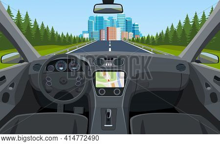 View Of The Road From The Car Interior. Road Way To City Buildings On Horizon. Vehicle Salon, Inside