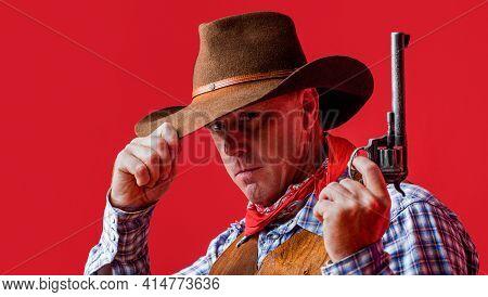 American Bandit In Mask, Western Man With Hat. Man Wearing Cowboy Hat, Gun. West, Guns. Portrait Of