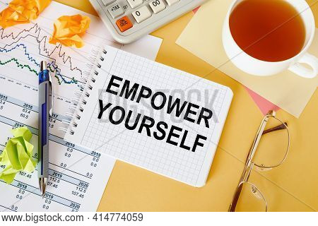 Business Concept - Workspace Office Desk And Notebook Writing Empower Yourself