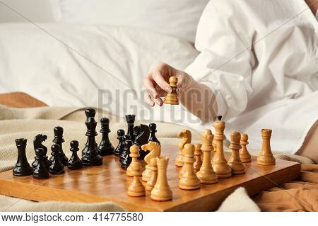 Chess Player Woman Learns Chess Opening By Playing With Himself. White Pawn One Step Forward. Chess