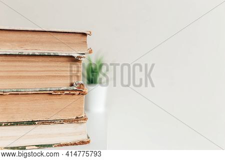 A Stack Of Old Books In The Library, Concept Of Learning, Study And Education, Concept Of Science, W