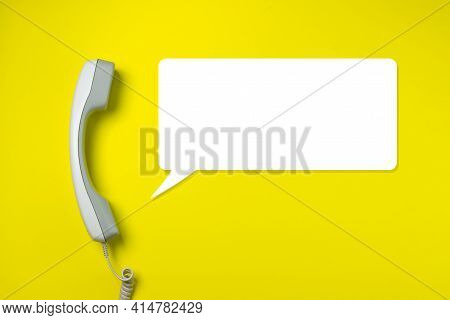 Telephone Receiver On A Yellow Background. There Is A Place For An Inscription And A Logo.