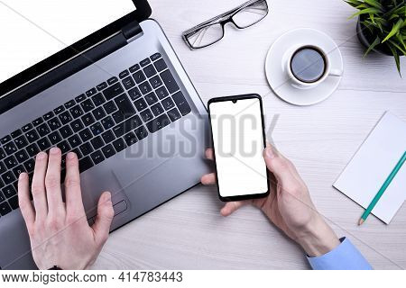 Man Using Laptop At Home In Living Room. Mature Businessman Send Email And Working At Home.work At H
