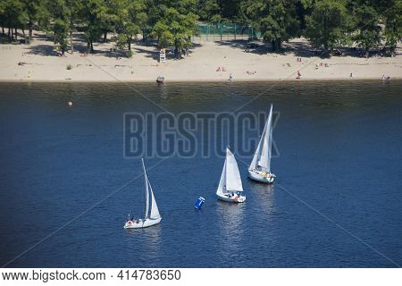 Three Yachts On The Dnieper River. Friends On Yachts On River. Sports Or Recreation On The Water. Ra