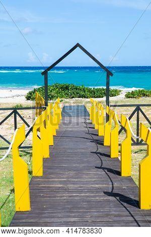 Cuba, Baracoa, Beach With Blue Water, Wooden Path