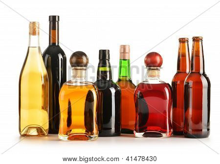 Composition with bottles of assorted alcoholic products isolated on white poster