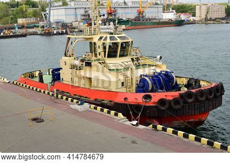 Port In Odessa. Tug Ship Bow With Large Rubber Wheels. Big Tires Of The Deck Of A Tug Boat, Safety B