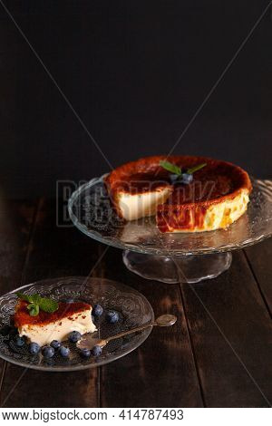 Homemade Basque Burnt Cheesecake With Cream Cheese, Eggs And Cream Baked In A Crumb Crust. A Slice O