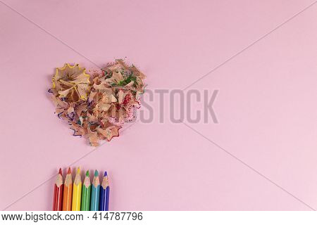 Sharpened Colored Pencils And Heart-shaped Pencil Shavings On Pastel Pink Color. Rainbow Or Lgbt Pen