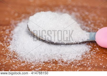 Monosodium Glutamate On Spoon And Wooden Table Background, Msg For Food Seasoning