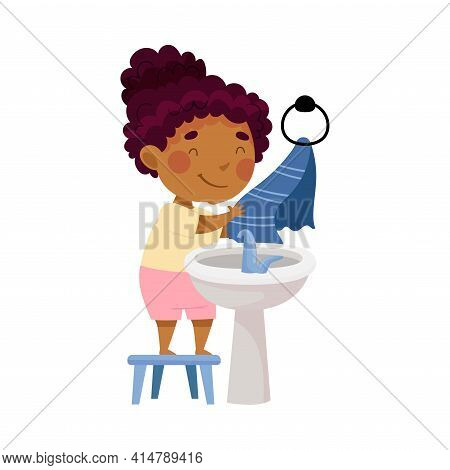 Cute African American Girl Standing On Stool Near Wash Stand Drying Hands On Towel Engaged In Person