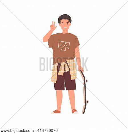Portrait Of Happy Teenager Standing With Skateboard, Winking And Showing V Sign. Young Skater In Str