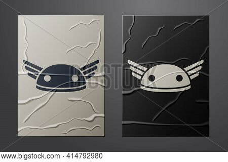 White Helmet With Wings Icon Isolated On Crumpled Paper Background. Greek God Hermes. Paper Art Styl