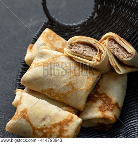Thin Pancakes Stuffed With Meat Filling. Tasty Homemade Crepes Rolled With Chicken Or Beef Filling.